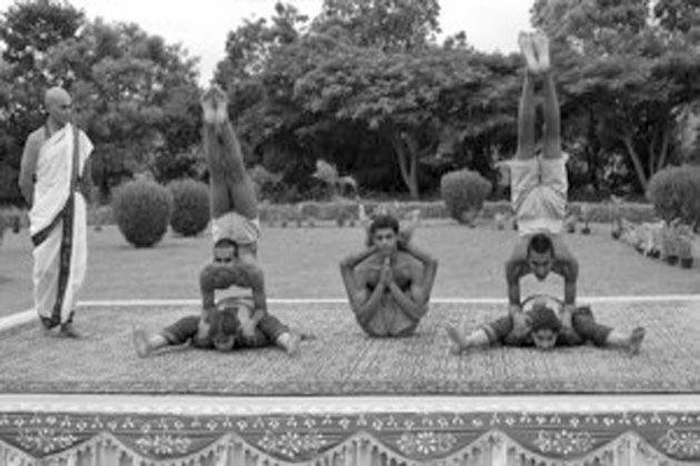 1930: Krishnamacharya with his students at the yoga shala at the Mysore Palace (vintage yoga style photo)