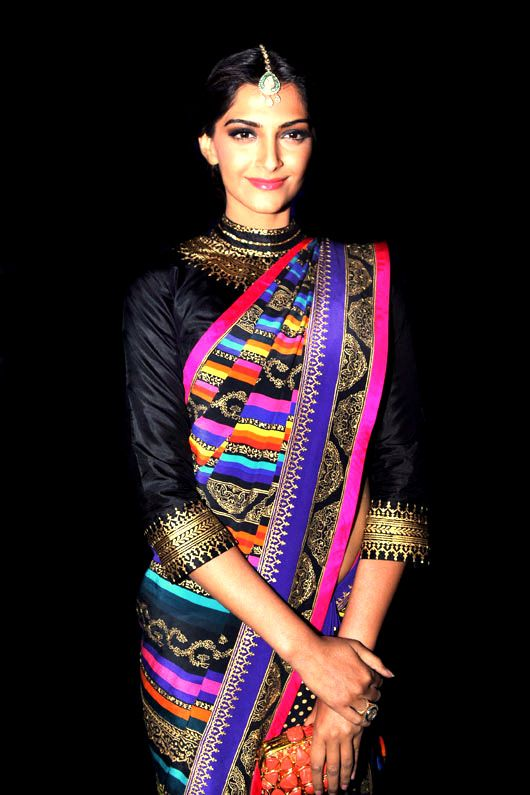 Sonam Kapoor in a Manish Arora saree and blouse. Graphical and colorful. Bollywood Indian fashion.