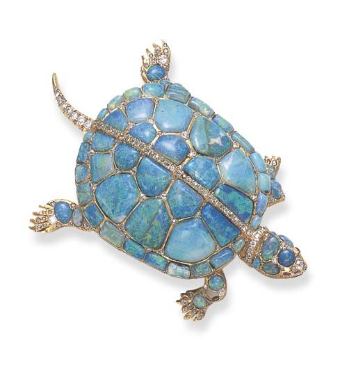 A RARE ANTIQUE OPAL, DIAMOND AND RUBY TURTLE BROOCH  Realistically designed as a calibré-cut black opal turtle, enhanced by cushion-cut ruby eyes and single, rose and old mine-cut diamond detail, mounted in gold, (one small black opal deficient on foot), circa 1870