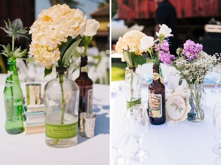 17 best images about centerpieces on pinterest wedding for Liquor bottle vases