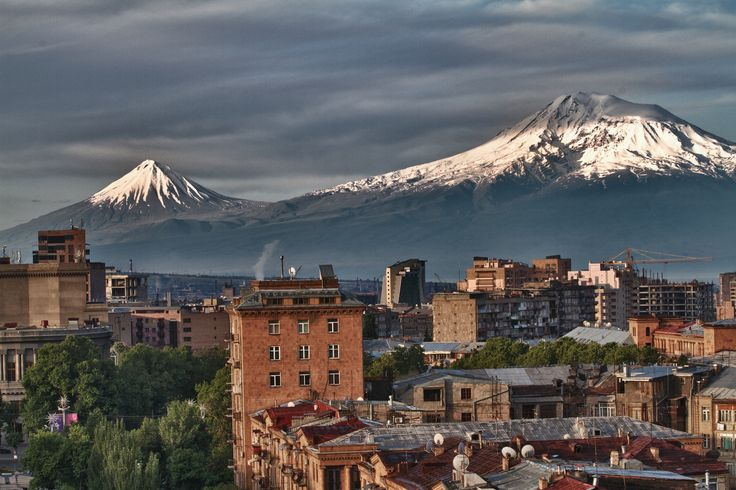 "Mount Ararat as seen from the Armenian capital Yerevan. Located in eastern Turkey, Mount Ararat stands at an elevation of 5,165 m and forms a  near-quadripoint between Turkey, Armenia, Azerbaijan and Iran. The name ""Ararat"" derives from the biblical tradition (Genesis 8:4) linking it with the Mountains of Ararat where Noah's Ark came to rest after the great flood."