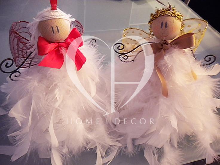 angeli di piume con ali in ferro battuto