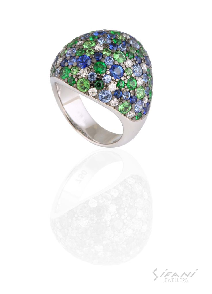 Blue sapphires, green tsavorites and diamonds set in a white gold ring