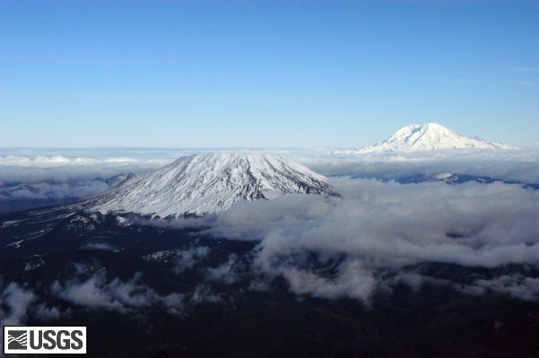 Aerial view of Mount St. Helens and Mount Rainier.   USGS Photograph taken on December 11, 2004, by John Pallister.  Flew over both of these today. 6/2012