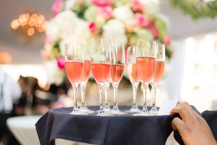 Wedding cocktail hour drink inspiration: passed rose champagne. Perfect for a pink wedding! (Eric & Jamie Photography)