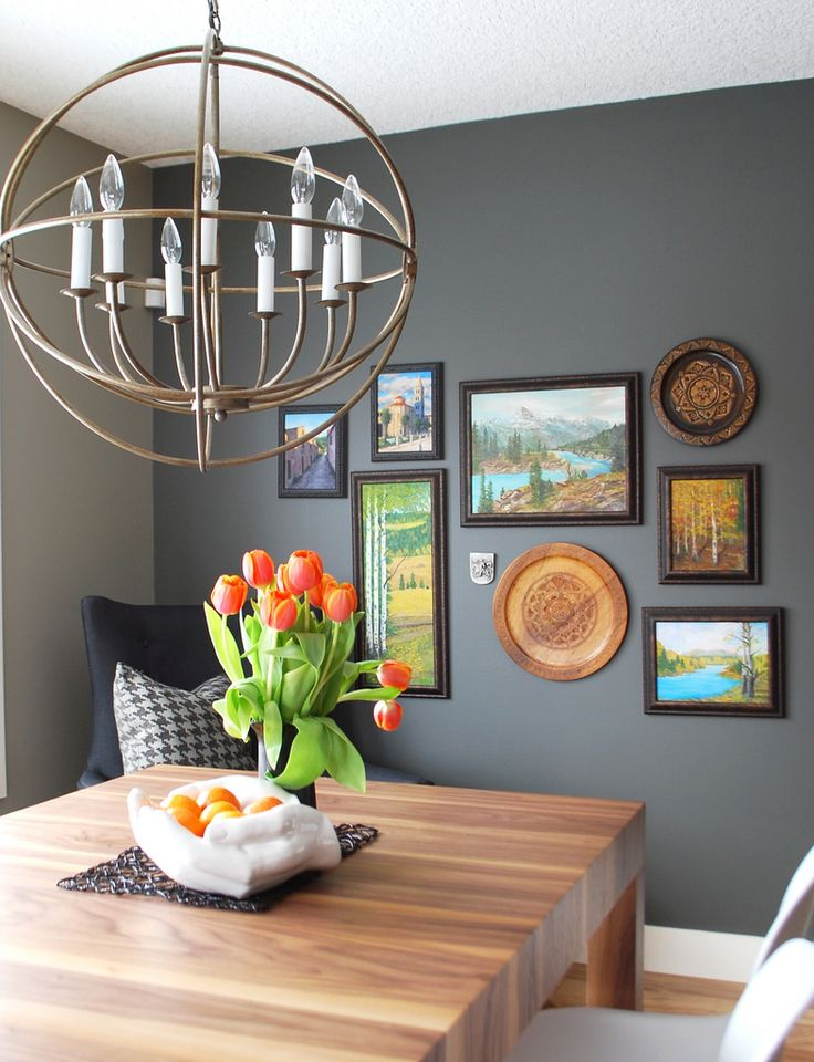 gallery wall in kitchen on wall painted dark grey
