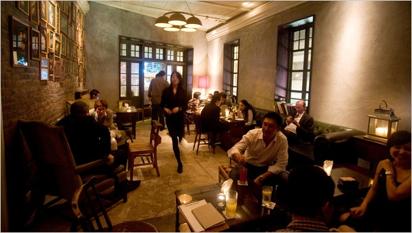 """Interior of the pawn (3-4 stories) one level of bar and lounge. others are restaurant seating space. 1920s Hong Kong/""""rickshaw"""" feel"""