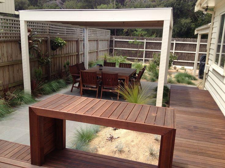 Entertainment space bluestone paving ,decking and Australian native garden
