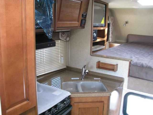 2016 New Lance 855S Truck Camper in California CA.Recreational Vehicle, rv, 2016 Lance 855S 877-485-0190 CALL DAVID MORSE 4 BEST PRICE 877-485-0190 CALL DAVID MORSE 4 BEST PRICE,REMOTE JACKS AND SLIDEOUT,DUAL PANE WINDOWS,AIRCONDITIONING,AWNING,WITH AWNING TOPPER,FLATSCREEN TV,DVD,AMFMCD,SLIDEOUT DINETTE WITH OVERHEAD BUNK,FRONT QUEEN BED,OUTSIDE SHOWER,MICROWAVE AND REGULAR OVEN,4 SEASON COACH.