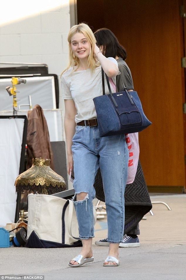 Dressed down: Elle Fanning, 19, seemed to take a break from promoting her new film The Beg...
