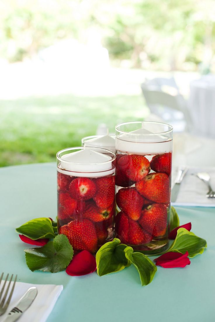 Getting married picnic style? Simple yet elegant, this strawberry inspired centerpiece can be thrown together in next to no time. Get yourself a few punnets of fresh strawberries, remove the stems and immerse in clear, cold water. For added drama float a candle on top! - That is all..