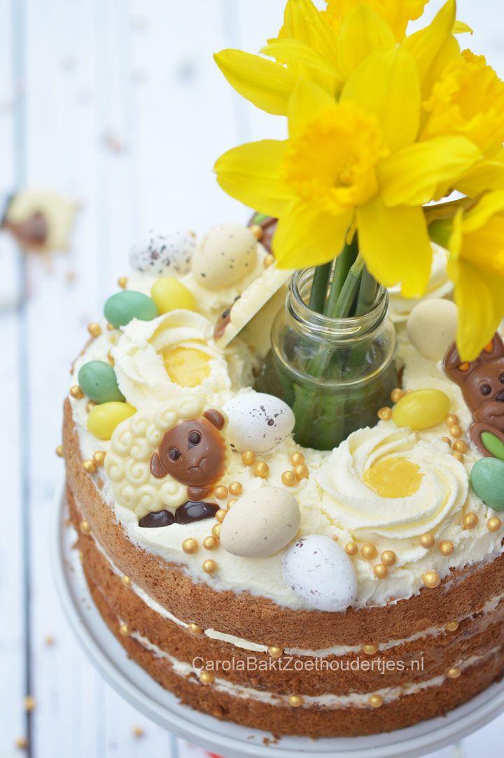 Paastaart met chocolade en verse bloemen Easter cake with chocolates, eggnog and fresh flowers.
