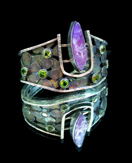 Cuff    Michael Johnson.  Vesica Pisces 2011.  sterling silver with patina, end-cut amethyst, and two different types of cuts of faceted peridot