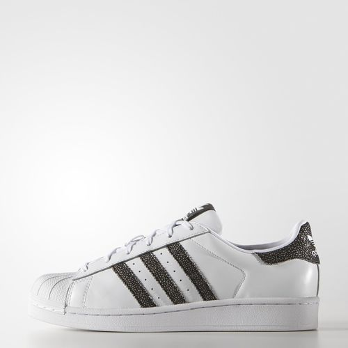 These women's adidas Superstar shoes have a smooth leather upper and  textured ...