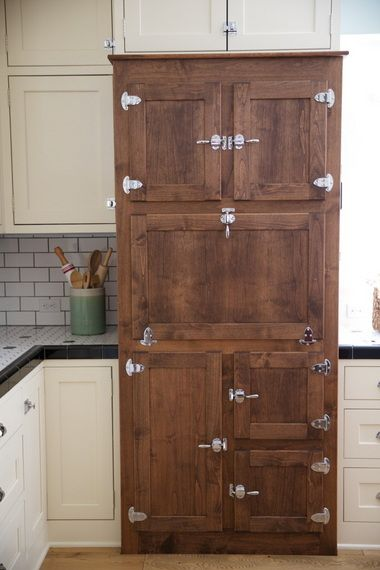 Kitchen cabinet made to look like an old icebox ... What a Great Idea!
