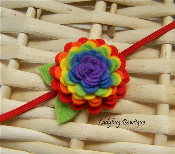 rainbow headband-- this is really cute @Amy Wadeson, but you're the sewer, not me... though maybe we could use fabric glue for something like this?  And colored stretch elastic making it easy to slip on? Still working on the knit rainbow headband.. but no promises on how it will turn out.