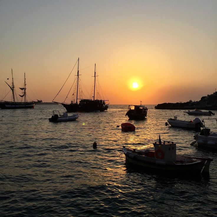 """LOVE GREECE LIKE THEY DO! Ryan Serhant ,Broker in New York and 6 in the Nation as ranked by Wall Street Journal Real Trends 2015. """"Our view last night as the sun set over the Aegean Sea, from our table at Dimitri's in Ammoudi's Beach, 250 steps below the village of Oia (all the white buildings on the cliff I keep posting). If you ever come to Santorini, you must go here.  And make sure to carb load on their famous lobster linguine - you'll need the energy for the hike back up!"""""""