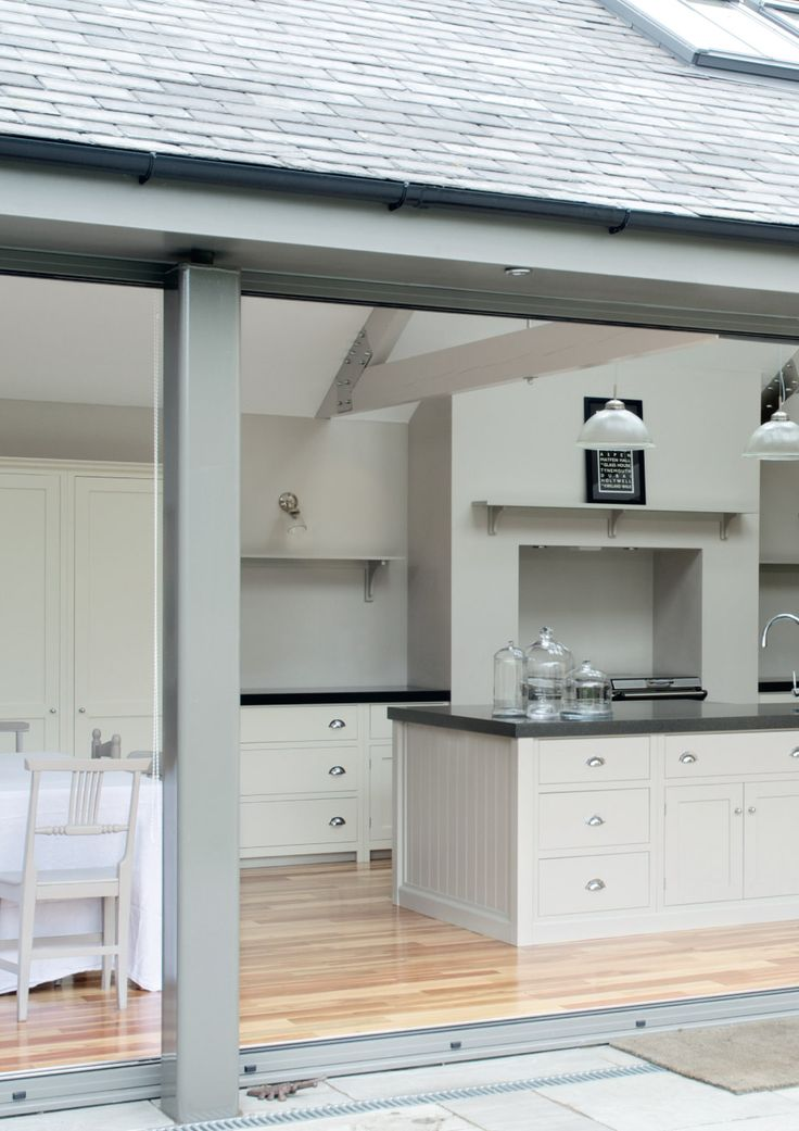 This is similar layout to our plans - looking from pation thru folding doors onto island and range/Aga. Love the colour and overall look | deVOL Kitchens and Interiors