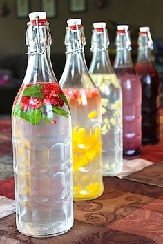Supplies: 1 Quart Glass Bottle with Stopper or you can use this infuser water bottle Plastic mini funnel From front to back; mint raspeberry, strawberry mango, lemon ginger, blueberry, grape. After the first fermentation, add your choice of fruit and...