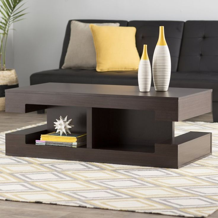 Complete your living room or den space in chic style with this  condell coffee table. Showcasing a stacked design, an espresso finish, and open shelves, this must-have accent brings sleek style and essential storage space to your home. Top it with clean-lined yellow vases and a small abstract sculpture, then fill the lower shelves with glossy art books and magazines for a can't-miss mod-inspired display in your living room. Or if midcentury is not what you're looking for, try topping ...