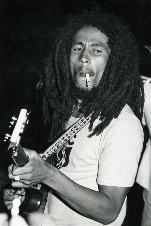 Bob Marley smoking a HUGE joint while playing