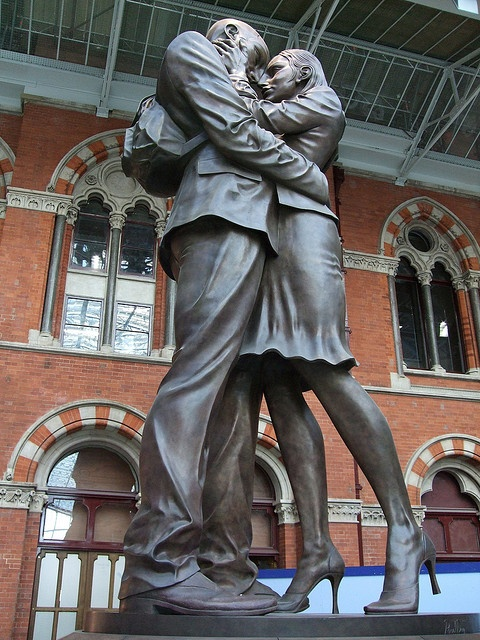 """""""The Meeting Place"""" statue at the St. Pancras international railway station in Camden, England. Built to celebrate the train station that now allows a train to travel through the chunnel to France."""