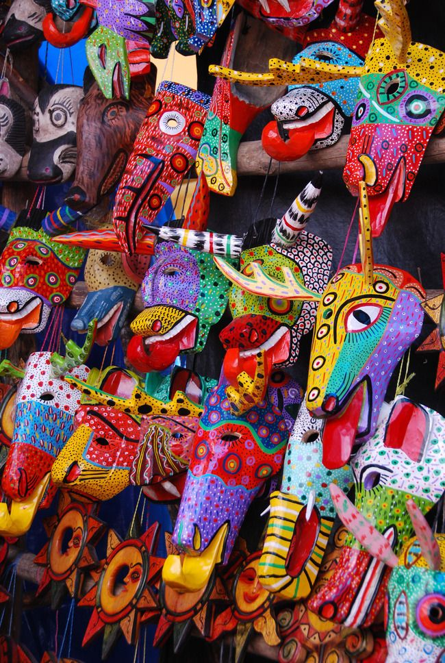 Some of the colorful wooden masks in the Chichicastenango market #Guatemala