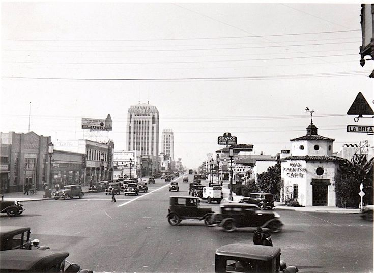 Here, we're looking west along Wilshire Blvd from the corner of La Brea Ave in December 1932. Pretty much the only thing still standing in this photo is the Dominguez Building which used to house the Myer Siegel & Co. department store, and the Art Deco building farther along at 5500 Wilshire worth slowing down for if you're driving past it. I especially love that cute little Dyas-Carlton Café on the corner; it later became the much larger McDonnell's Wilshire Café.