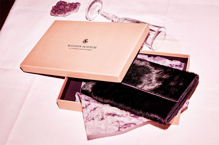 The purse carried her world and more... A faux pony hair travel wallet by Scotch & Soda