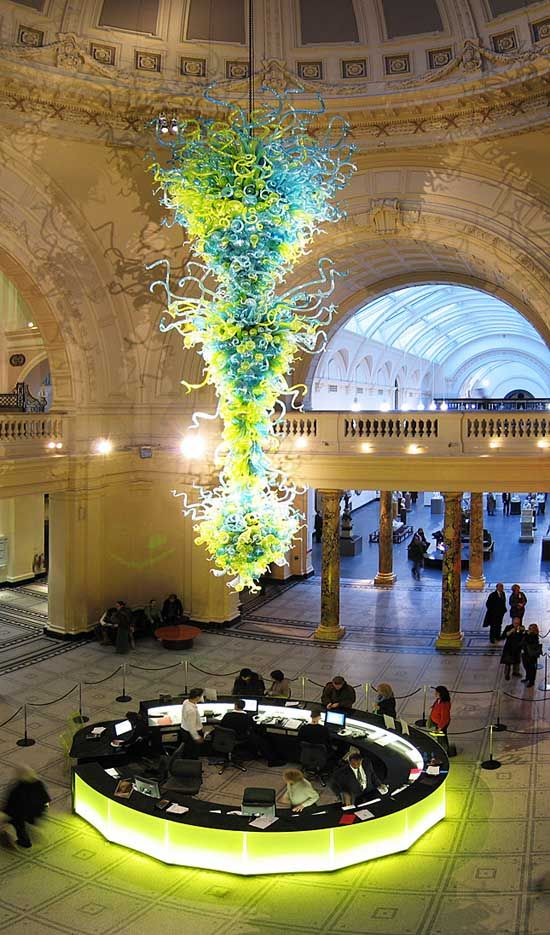 Chihuly's enormous glass Chandelier under the dome of the main entrance of the Victoria and Albert Museum presents an interesting cleaning problem. The Chandelier is fixed in position so it is necessary for a heroic member of the Museum's technical staff to brave the heights on a 'Powerscope' - a type of raising platform.