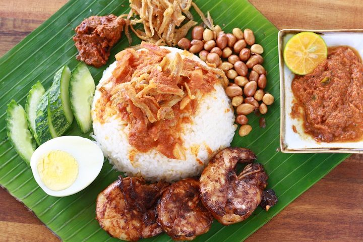 Nasi Lemak. Nasi lemak is a fragrant rice dish cooked in coconut milk commonly found in Malaysia, Brunei, Singapore,[1] Riau Islands and Southern Thailand. Malaysia proclaims it its national dish and a national heritage of Malaysia, although it's widely served in other parts of the region