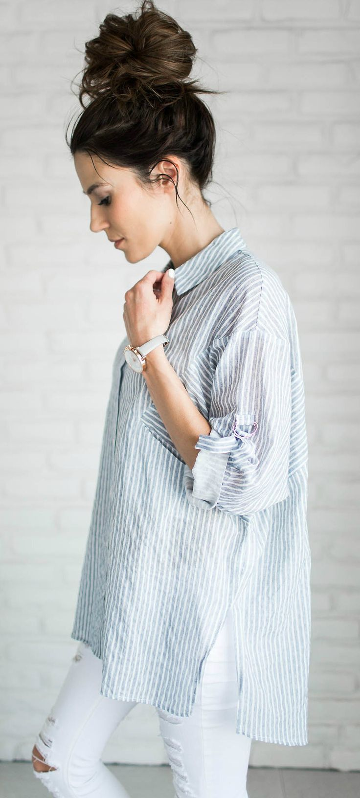 Top knot + button down striped top.