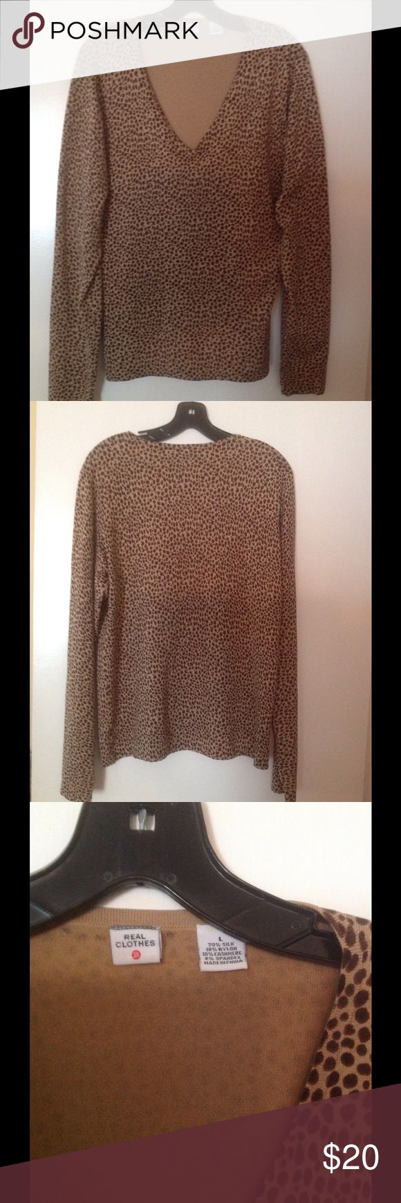 Brown and tan animal print, long sleeve top Beautiful animal print, V neck, long sleeve top! ❤️ It's soft and comfortable! ❤️ Top is made of 70% silk, 18% nylon, 10% cashmere and 2% spandex! ❤️ Top is used only once and in great condition! ❤️ Real Clothes Tops Blouses