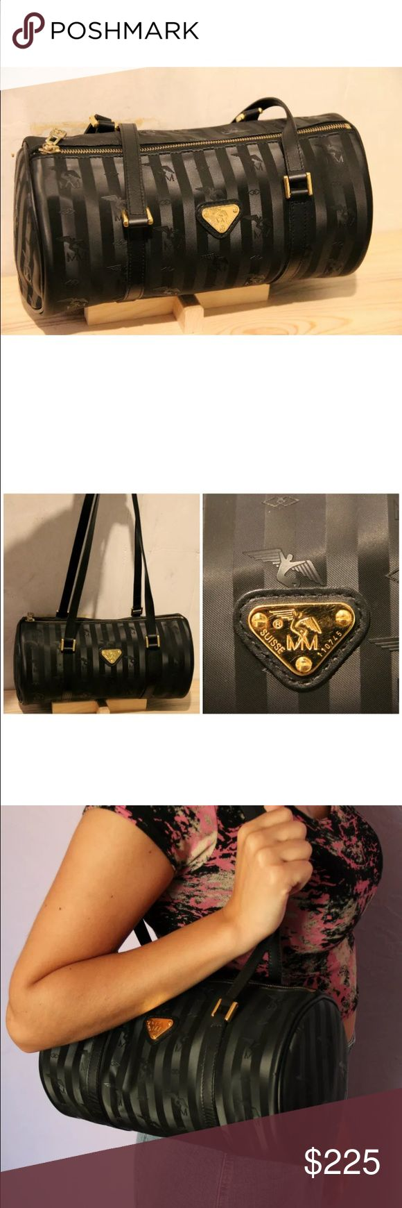 Mollerus purse In excellent used condition. A Swiss designer name brand. Beautiful vinyl material that won't scratch and will last forever. Mollerus Bags Shoulder Bags
