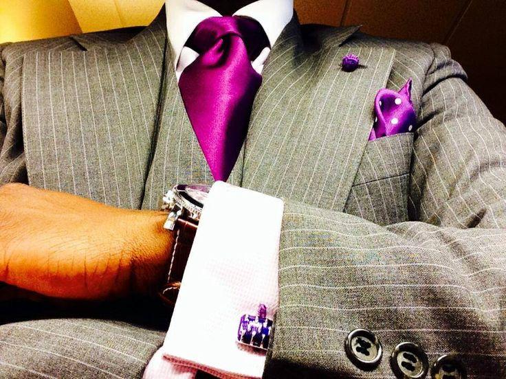 grey pinstripe suit, purple tie
