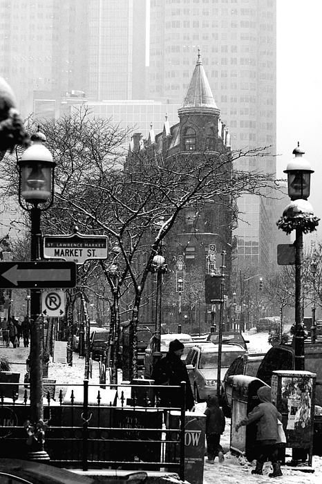 "A snowy January morning brought me out to shoot Toronto's ""Flatiron"" building. I wanted to shoot it in an unconventional way, if I could. I backed away to the south east corner of Front and Market streets to take in a bit of the bustle of the St. Lawrence Market area. #Toronto, #flatiron, #snow"