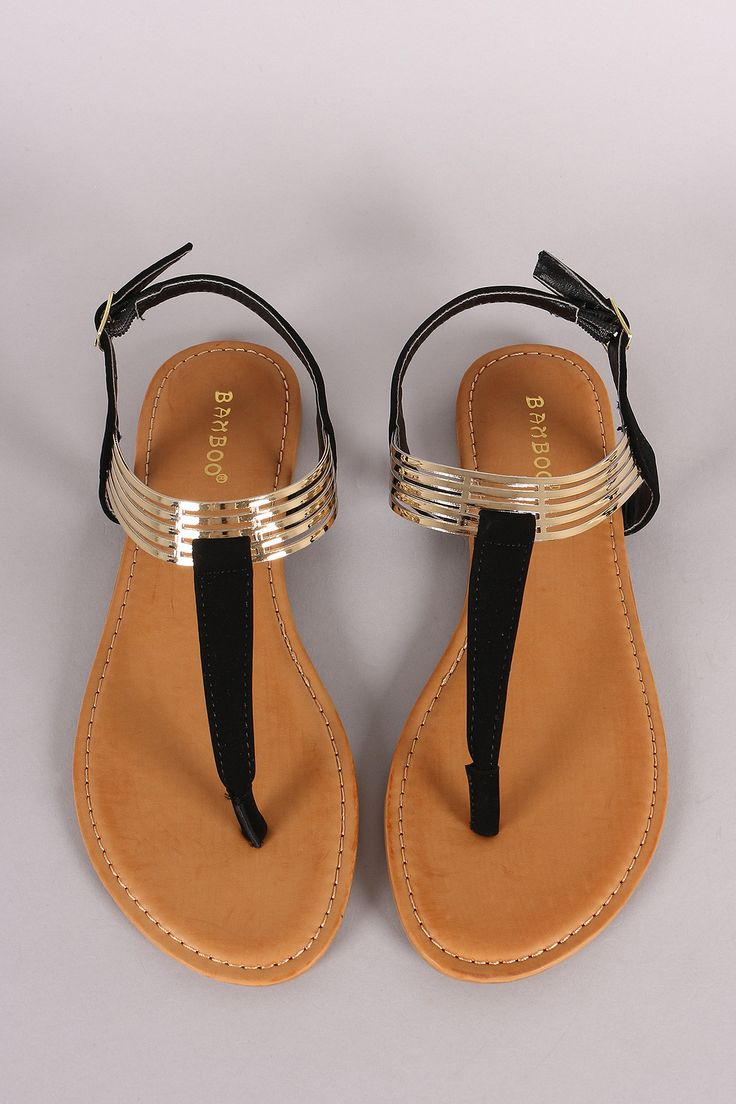 Description This edgy flat sandal features a T-strap construction with metallic cut out cuff detail. Finished with a lightly padded insole, and adjustable slingback strap with buckle fastening. Materi