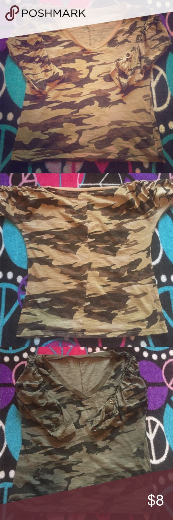 Two camouflage medium sleeve shirts. One is army green. Other brown. Green is a medium and brown is small. The both stretch to the belt of your pants. Sleeves stops at elbow. God with any pair of jeans or black if you prefer. Tops Tees - Long Sleeve