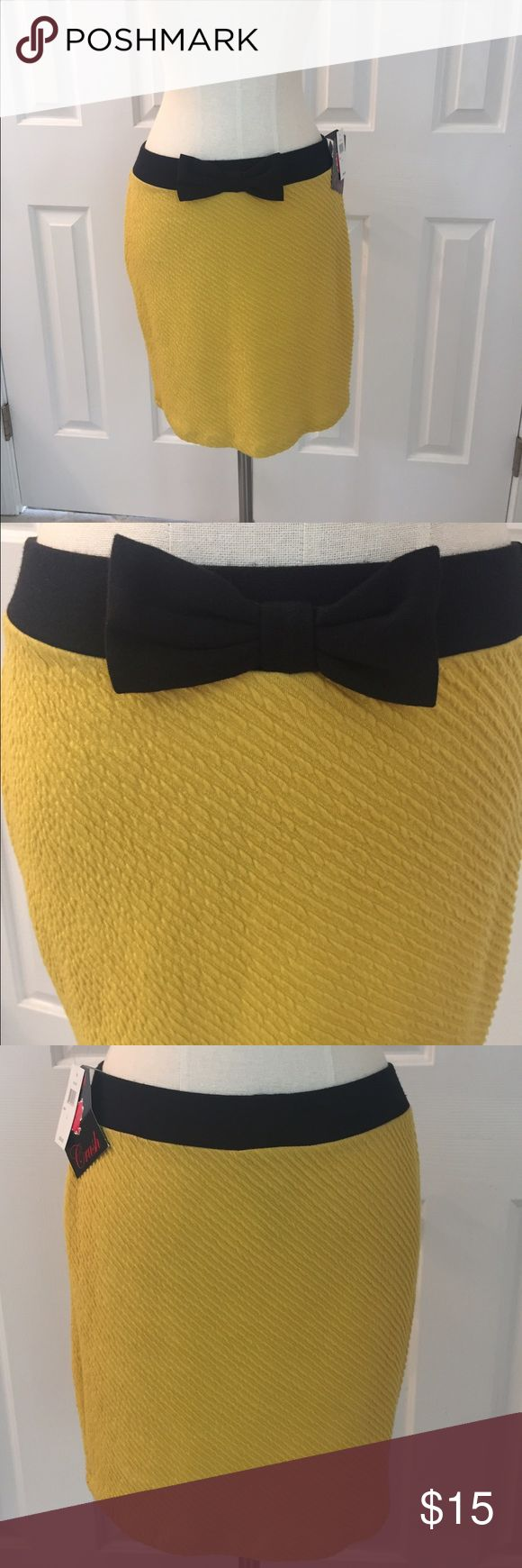 NWT Sexy Yellow Bow Stretch Skirt Large NWT Sexy yellow stretch skirt with black waistband and bow. Size Large poly/Spandex . Heart Crush Skirts