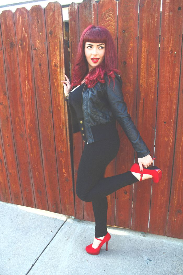 Bangs, red hair,  and leather jacket.