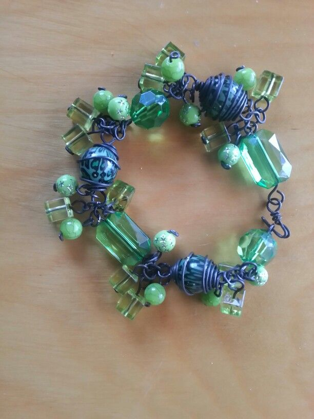 Green with Envy:  Charm Bracelet completely handcrafted from 20 guage black steel,  wire wrapping, acrylic beads.