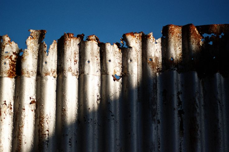 Rusted iron fence. I really like the textures on this fence with the rust and the flaking surface.