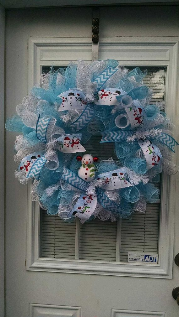 This wreath would be super cute for your front door for winter. It has Snowman printed ribbon and blue chevron. I used blue and white deco