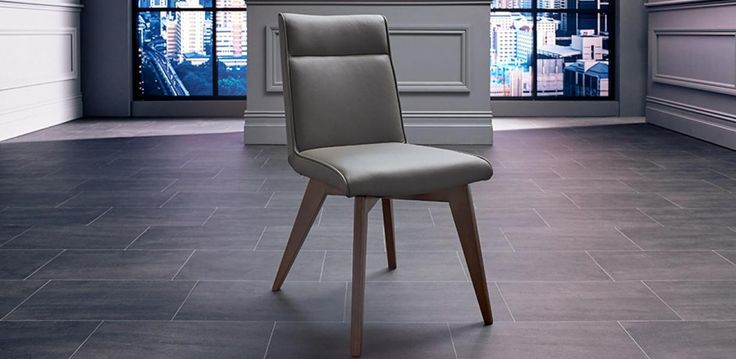 The Lucio chair, upholstered in a thick and sophisticated grey leather with…