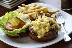 Artisan brews, ecclectic cuisine put Park Tavern on top. The Green Chili Burger comes stuffed with green chiles and cheese curds at Park Tavern in Rosemont.