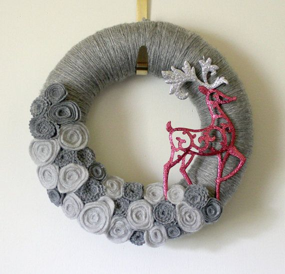 Wreath inspiration: could use crocheted snowflakes, felt circle flowers or crocheted flowers; I love the simple addition of the reindeer - could also just be a star, or snowman, or angel