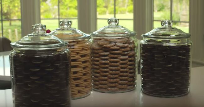 I've found that 5 packages of Oreos fill up the whole jar round wise, and about half way up the middle. Perfect for me since I don't eat cookies anyway lol. Looks great!