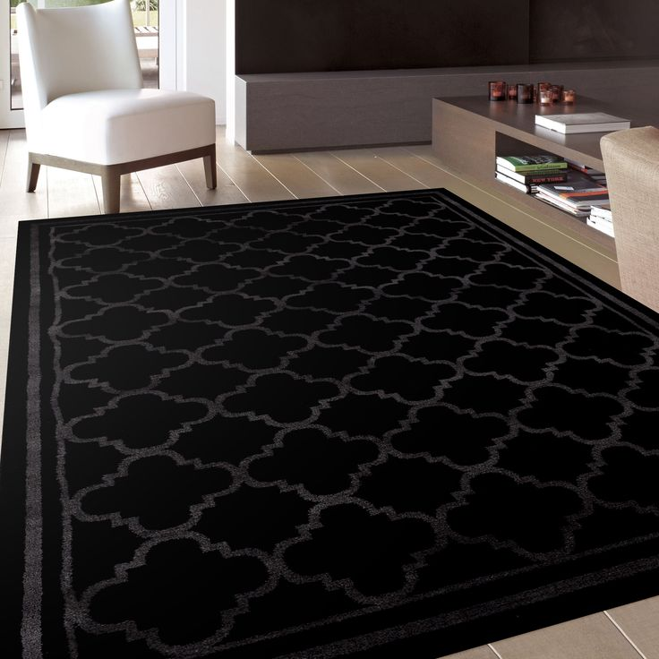 Decorate your home with this stylish contemporary area rug. The black rug features an attractive trellis design that adds function and fashion to any décor.