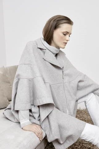 Cut from virgin wool-blend,this gray cape from ESCADA Sport is a chic layering piece.Detailed with notched lapels, a front zip fastening and wide sleeves,it's left unlined for added comfort.