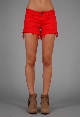Five pocket cut off shorts with a frayed hem in bold colors.